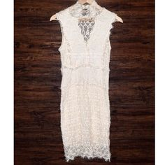 FREE PEOPLE Lace Dress Bodycon Eyelet Mini Formal Size Small. New without tags.  $335 Retail + Tax,  Ivory lace dress with keyhole opening and buttoned high neck. Sheer upper back & raw, unfinished seams. Lined body.   By Nightcap for Free People. Cotton/polyamide/elastane.      ❗️ Please - no trades, PP, holds, or Modeling.    Bundle 2+ items for a 20% discount!    Stop by my closet for even more items from this brand!  ✔️ Items are priced to sell, however reasonable offers will be…