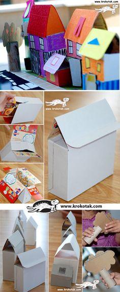Ciudad con cajas de cartón recicladas