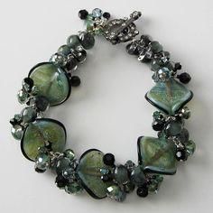 "Paula Huckabay of Pacific Jewelry Designs ... Sea Green glass bracelet ""Sea Treasures"" using Unicorne Beads Seashells."