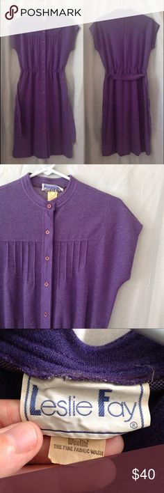 """1970s LESLIE FAY sleeveless dress In very nice condition except for a tiny stain on left side of bodice.  Barely noticeable.  Pretty shade of dark purple.  Feels like a polyester blend.  Buttons all the way down the front, with a tie at the elastic waist.  Hits below the knee.  Bust is 19"""" across and the waist is about 26"""" and stretches to about 30"""".  Color may look different on your screen. Vintage Dresses Midi"""