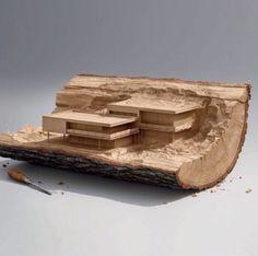 Architekturmodell aus Baumstumpf geschnitzt