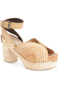 """Retro inspired Free People clogs are so right now. Chunky wooden heel and platform. Buckle ankle strap. - 4"""" heel; 2"""" platform (size 39). - 3"""" ankle strap height. - Adjustable ankle strap with buckle"""