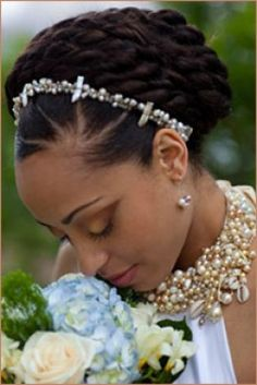 A braided bun creates a  soft and demure style, Natural style for the wedding day!