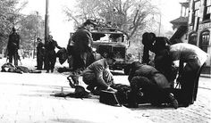 May 6, 1945. Employees of the Red Cross help victims of a gun fight between the BS and German military forces who wanted to leave Amsterdam by truck. The headquarters of the BS was located on the Amstelveenseweg. When the truck passed by the BS headquarters a gun fight erupted. Photo ANP Historisch Archief Community / C. Breijer #amsterdam #1945