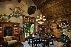 Trophy room in a log house...talk about man-cave!