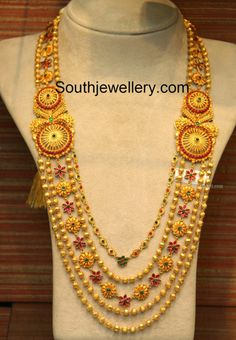 22 carat gold antique finish gundla haram with three gold ball chains, one paisley motifs chain and one floral motifs chain attached to side pendants. This haram is available from Malabar Gold and Diamonds. Jewelry Design Earrings, Gold Earrings Designs, Necklace Designs, Gold Jewellery, Jewellery Designs, Gold Designs, Designer Jewellery, Antique Jewellery, Pendant Jewelry