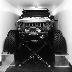 Jeep Wrangler strapped down - https://www.pinterest.com/dapoirier/4x4-and-trucks/