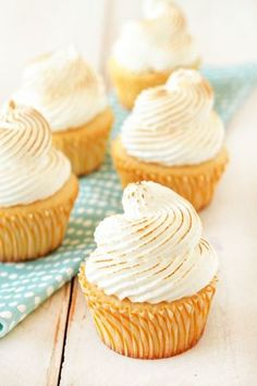 Lemon Meringue Cupcakes. Light lemon cupcakes, filled with lemon curd and topped with meringue frosting.
