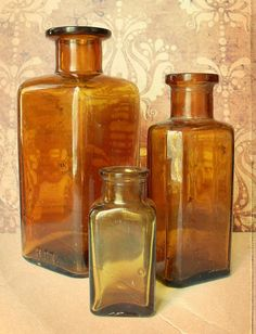 Here are three antique amber glass bottles.    They are about 5 1/2, 4 1/4, and 2 1/2.    They are both in used and aged condition, with no cracks