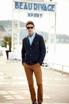 Shop this look on Lookastic: http://lookastic.com/men/looks/sunglasses-scarf-longsleeve-shirt-blazer-chinos-loafers/4936 — Black Sunglasses — Charcoal Silk Scarf — Blue Vertical Striped Long Sleeve Shirt — Navy Knit Blazer — Tobacco Chinos — Black Leather Loafers