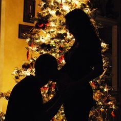 "Beautiful! ""Picture of me kissing our 33 week old baby boy on his first Christmas"""