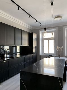 Cosentino is setting the mood and raising the bar for interiors. Silestone Et. Marquina and dark, dramatic cabinetry add flair to this moody kitchen. (Photography by Carlos Franjola) Black Kitchens, Luxury Kitchens, Kitchen Interior, Home Interior Design, Black Kitchen Countertops, Minimalist Kitchen, Küchen Design, Modern Kitchen Design, Kitchen Remodel
