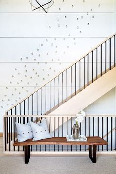"In the staircase, which is the first thing people see when entering the house, the team at Workshop APD installed a climbing art installation using barnacles. ""We found the barnacles years ago and..."