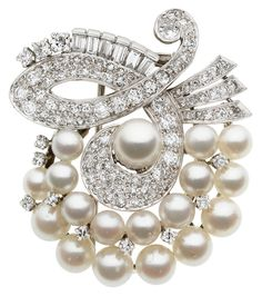 Cultured Pearl, Diamond, Platinum Clip-Brooch, circa 1950 The brooch features cultured pearls ranging in size from 4.20 x 4.40 mm to 6.60 x 6.70 mm, enhanced by full and single-cut diamonds weighing a total of approximately 2.35 carats, accented by baguette-cut diamonds weighing a total of approximately 0.40 carat, set in platinum, completed by a double pinstem and catch mechanism on the reverse.