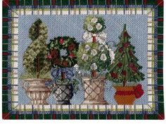 Wintertime Topiaries.  Who knew winter could be stitched so beautifully?!!
