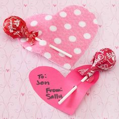 Stick a Tootsie Roll Pop in a paper heart that doubles as a valentine and a sweet gift. Use cardstock or thick scrapbook paper to make the heart, and punch two holes to secure the lollipop.