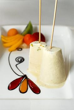 Kulfi is a frozen indian dessert made from full cream milk thinkened with khoya and chopped badam and pista.