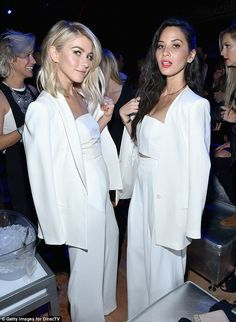 Seeing double?Julianne looked sensational in white trousers and a matching white corset top, with a white suit jacket hung over her bare shoulders - while Olivia wore nearly exactly the same outfit