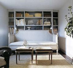 This is a perfectly elegant way to make good use of a small office. This could easily multi-task as a guest room by throwing some pillows and blankets on the sofa...