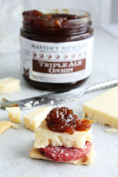 Triple Ale Onion Savory Spread. 2014 Sofi Gold Winner for Outstanding Condiment. A sweet sticky onion spread hand crafted with 3 artisan ales. The BEST cheese pairing. Slather over steak sandwiches, burgers and baby back ribs. Add to grill cheese, paninis and perfect for the summer grill! Shop online @ http://www.wozzkitchencreations.com/collections/gourmet-food-online/products/triple-ale-onion-spread