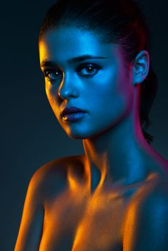 Geoffrey Jones, photographer. Gelled lights. CTO, CTB and Minus Green (I think). I would like it better with blue and magenta lights located on opposing sides, with the tungsten color modeling the subject from the front.