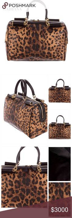 "NWT DOLCE & GABBANA BOSTON BAG Dolce & Gabbana with gold-tone hardware, leopard print throughout, black leather trim, dual rolled top handles, top zip closure, detachable flat shoulder strap and designed in caramel and espresso coated canvas. Interior: dual interior wall pockets; 1 w zip closure. Colors: Tan, Brown, Caramel & Black. Approx Measurements: Shoulder Strap Drop 16.5"", Handle Drop 3.5"", Height 9.5"", Width 12"", Depth 5"". This is a gorgeous Boston Bag!! Condition: Pristine-NWT…"