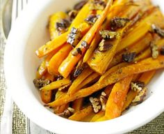 Sweet maple syrup and pecan nuts go brilliantly with roasted carrots in this festive vegetarian side dish. Recipe from BBC Good Food Bbc Good Food Recipes, Healthy Eating Recipes, Cooking Recipes, Yummy Food, Roasted Parsnips, Roasted Pecans, Carrot Recipes, Veggie Recipes, Brown Sugar Roasted Carrots