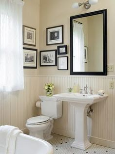 """Another beadboard wainscot bathroom. The toilet and sink are Kohler Memoirs - makes this room feel much more """"old fashioned"""" than the toilet and sink in the other bathroom, right? The white hexagon ceramic tile floors are pure classic as well."""