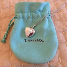 Tiffany's Sterling Silver Heart Locket Only worn once. Excellent condition. Kept in original box as shown. Practically New! Tiffany & Co. Jewelry Necklaces