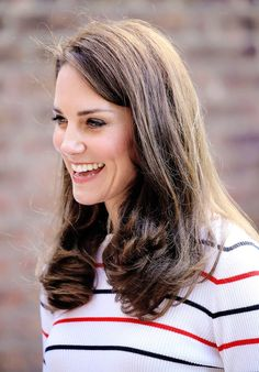 Catherine, Duchess of Cambridge speaks with runners from Team Heads Together ahead of the 2017 Virgin Money London Marathon, at Kensington Palace on April 19, 2017 in London, England.