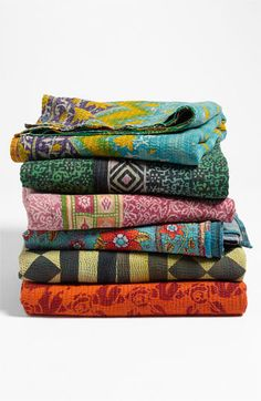 If you need something unique, then this Vintage kantha quilt is it! These beautiful Fair trade Kantha Quilts are hand stitched. The fabric is softly quilted, with bold prints and a beautiful colorful kantha running stitch is used all over the quilt. The reverse side is embroidered with many delicate kantha stitches which makes this a one of Kind!