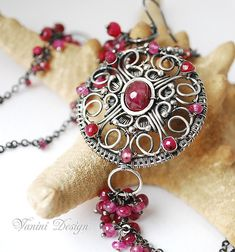 Medieval medallion - Silver,rubies and sapphires Set of medallion necklace and earrings by VaniniDesign, via Flickr