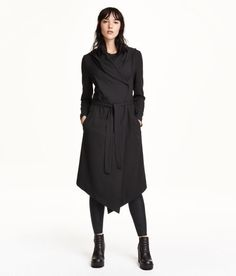 Check this out! Double-breasted coat in lightly woven crêpe fabric. Hood, side pockets, concealed snap fasteners at front, asymmetrical hem with slit at back, and a tie belt. Unlined. - Visit hm.com to see more.