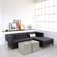 Love the mid-century feel to this sectional!  Usually they're so boxy but this one is amazing...