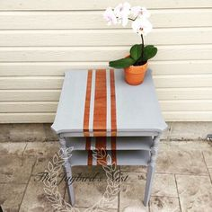 The Jaybird's Nest painted this end table in Thunderous by Heirloom Traditions Paint.  Taping off the areas to give it a grain sack striping pattern.  @paulablank