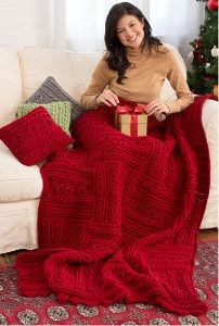 Start a fire and sink into your couch with the coziest Christmas crochet pattern ever. This is the most luxurious cable crochet blanket out there. It even includes crochet pillow patterns! | AllFreeCrochetAfghanPatterns.com