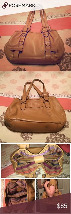 Etienne Aigner leather bag Soft, camel colored leather. It's a wonderful bag! Tons of storage inside, lots of great compartments. The inside is in excellent condition. Smudge spots on outside are shown in pictures. Bundle for a discount  Etienne Aigner Bags Shoulder Bags