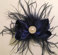 Holiday Feather Satin Hair Bows  from my Etsy shop https://www.etsy.com/listing/483280273/navy-satin-bow-feather-fascinator-bridal