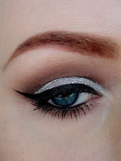 One of my fav makeup eye looks. Silver shadow on lid neutral crease.