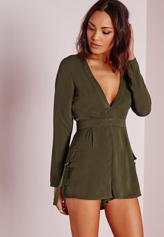 Battle it out in this Khaki playsuit. In a seasonal khaki colour and a plunge neckline, you'll be turnin' those heads. For a throw-on-go style, team with black caged heels and a patent clutch for all-round glam.