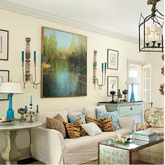 Love the splash of aqua throughout the room and all the textures that make room so cozy.