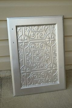 faux tin tile cabinet door tutorial-turn a plain bathroom vanity cabinet into an awesome one