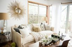 boho chic furniture small table long table sofa windows pillows glass door lamp beach style living room of Fabulously Cool Boho Chic Furniture Pieces to Consider Getting