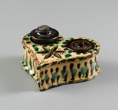 "Inkwell, John Holland, Salem, North Carolina, 1810-1813. Lead-glazed earthenware. H. 5"".  (Old Salem Museums & Gardens.) --- Art in Clay: Masterworks of North Carolina Earthenware by Old Salem Museums and Gardens, Chipstone Foundation, and Caxambas Foundation."