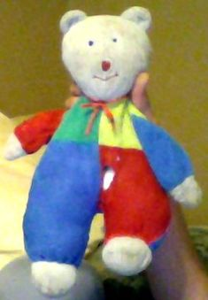 I'm looking for an early white bear with multi-color body - one red arm and one blue, half green and half yellow chest, one red leg and one blue. First Christmas, Searching, Dinosaur Stuffed Animal, Give It To Me, Arms, Plush, Toy, Posts