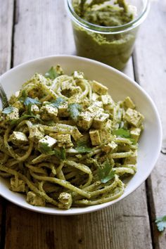 Easy & delicious dinner of kale and herb pesto tossed with hot pasta & cubed tofu.