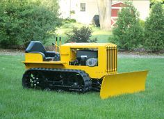 Dad Builds Mini Bulldozer from Lawnmower Parts