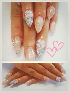 Nude and silver holo glitter almond stiletto nails with acrylic 3d charms and rhinestones