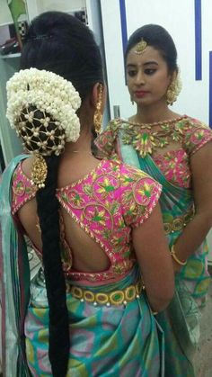 South Indian bride. Gold Indian bridal jewelry.Temple jewelry. Jhumkis. Teal blue silk kanchipuram sari with contrast pink blouse.Braid with fresh jasmine flowers.Tamil bride. Telugu bride. Kannada bride. Hindu bride. Malayalee bride.Kerala bride.South Indian wedding.