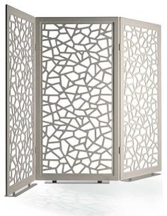 The Moucharabieh Screen is an elegant piece designed especially for Poltrona Frau.  It features a pattern of polygons of various shapes and sizes representing a microscopic detail of leather grain.  This showpiece gives great depth of scene.  The structure is made up of frames with aluminum profiles, the corners strengthened by steel and plastic.